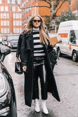 top striped top coat black coat pants black pants cropped pants vinyl boots white boots turtleneck
