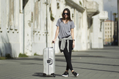 fashion vibe,blogger,t-shirt,sunglasses,casual,suitcase,shoes,pants,sweater,jewels