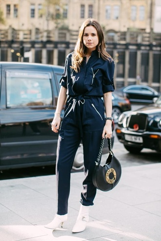 jumpsuit london fashion week 2017 fashion week 2017 fashion week streetstyle black jumpsuit bag black bag loewe bag boots white boots ankle boots high heels boots pointed boots