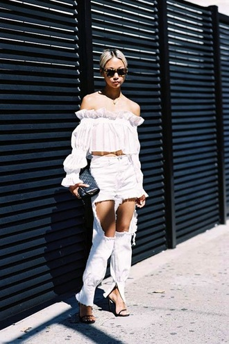 le fashion image blogger white top off the shoulder black bag white jeans ripped jeans all white everything peasant top white ripped jeans off the shoulder top white off shoulder top ruffle ruffled top crop tops white crop tops top blouse white blouse the haute pursuit tortoise shell tortoise shell sunglasses clutch black clutch spring outfits sandals ankle strap heels sandal heels high heel sandals black sandals