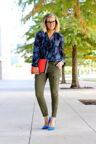 the courtney kerr blogger blouse khaki pants blue shoes