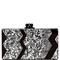 Silver confetti jean clutch with black acrylic and silver pearlescent vertical chevron design by edie parker | moda operandi
