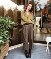 shoes,boots,black boots,leather boots,pants,wide-leg pants,cropped pants,belt,sweater,knitted sweater,v neck,earrings
