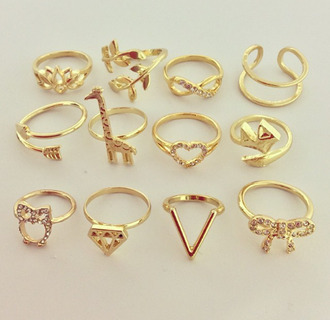 jewels ring gold gold ring gold jewelry gold cuffs cuffs sunglasses infinity ring heart jewelry vintage arrow bow ring v shape ring cute jewelry diamonds giraffe infinity bague knuckle ring heart birds rings and tings beautiful ring weheartit girly above the knuckle ring jacket dimond golden jewels summer shapes t-shirt