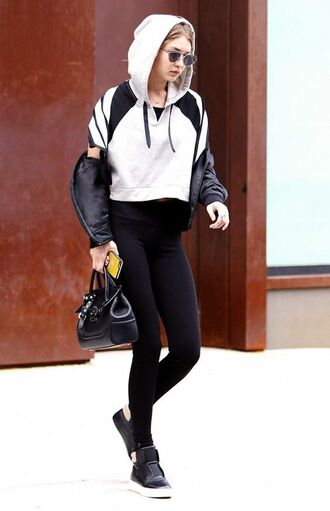 jacket gigi hadid celebrity model off-duty sportswear gym clothes leggings black leggings black jacket crop tops white top bag black bag sneakers black sneakers celeb gym clothes gigi hadid gym clothes