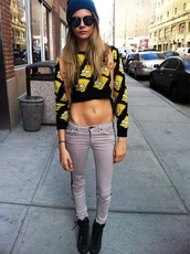 cara delevingne,sunglasses,cropped sweater,grey jeans,bart simpson,sweater,black grunge,grunge,jeans,celebrity style,model,skinny jeans,grey,casual,shoes,hat,shirt,crop tops