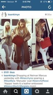 kim kardashian,camel coat,red bag