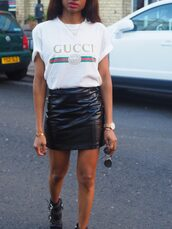 symphony of silk,blogger,top,skirt,bag,jacket,gucci t-shirt,gucci,leather skirt,mini skirt,ankle boots,t-shirt,white t-shirt,black skirt,lether skirt,black sunglasses,boots,black boots,white,shirt