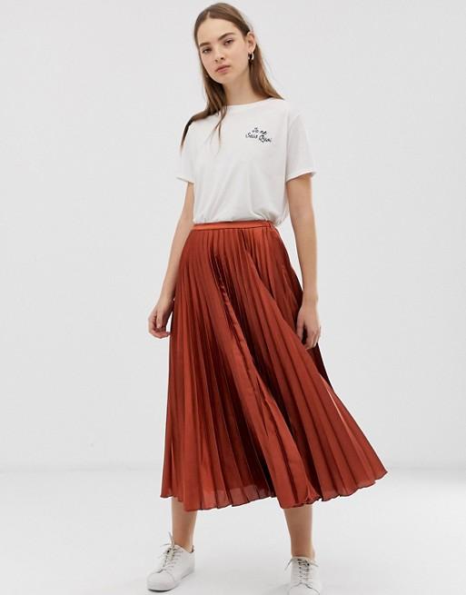 ASOS DESIGN pleated midi skirt in satin at asos.com