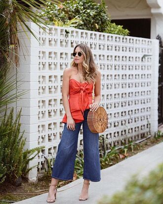 top red top jeans wide leg jeans sandal heels sandals bag round bag sunglasses rayban