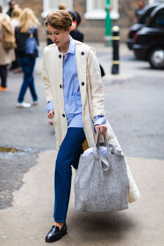 coat fashion week street style fashion week 2016 fashion week london fashion week 2016 nude coat long coat shirt blue shirt stripes striped shirt denim jeans blue jeans flats black shoes fall outfits streetstyle bag grey bag