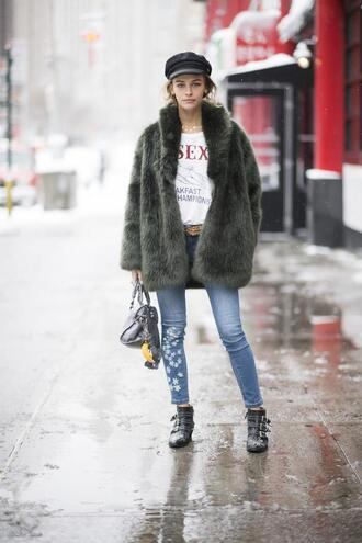 coat nyfw 2017 fashion week 2017 fashion week streetstyle green coat fur coat faux fur coat jessica alba denim jeans blue jeans boots black boots ankle boots susanna boots buckle boots bag black bag t-shirt quote on it fisherman cap hat