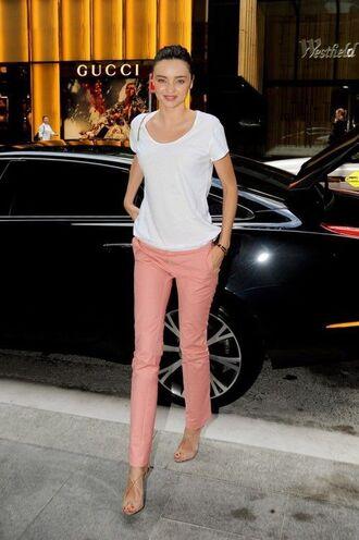 pants pink pants t-shirt white t-shirt miranda kerr model celebrity high heel sandals sandals nude sandals casual friday
