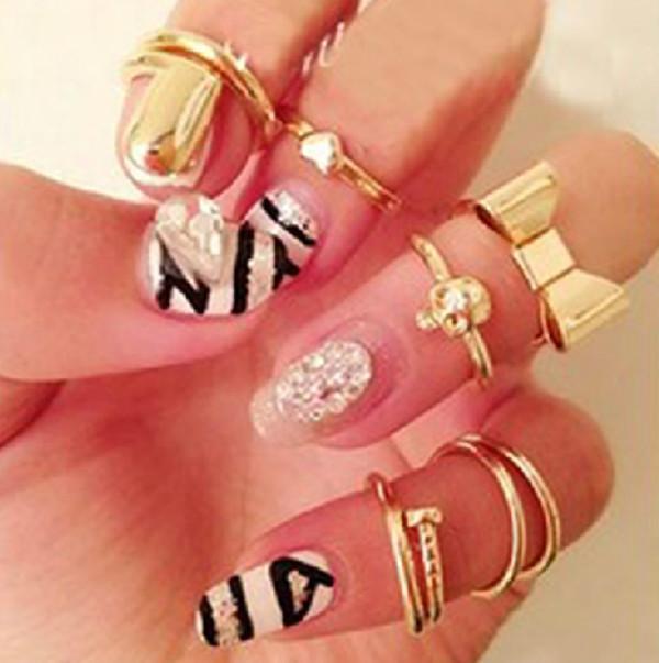 jewels ring knuckle ring knuckle ring ring gold midi ring nail polish gold midi rings bow heart skull