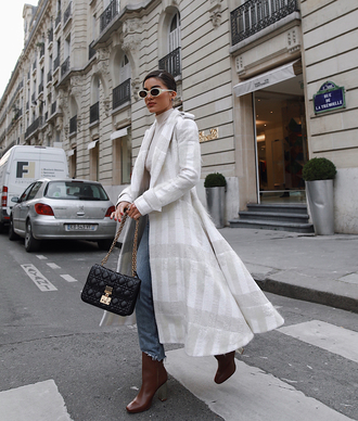 coat white coat long coat boots brown boots sunglasses streetstyle top jeans denim blue jeans