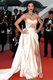dress,gown,prom dress,red carpet dress,red carpet,cannes,strapless,bustier dress,adriana lima,model,slit dress,shoes