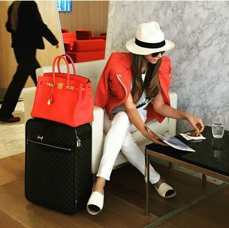 hat shiva safai celebrity jacket red jacket leather jacket pants white pants chanel espadrilles espadrilles bag hermes bag red bag white hat airport fashion