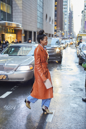 coat leather coat nyfw 2017 fashion week 2017 fashion week streetstyle orange denim jeans blue jeans wide-leg pants boots ankle boots printed boots high heels boots