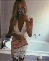 dress,white dress,short lengt,flowers on the bottom,lace on the botto