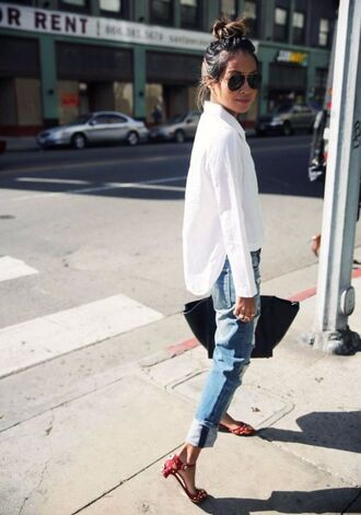 bun white shirt casual sincerely jules blogger streetstyle top knot bun blue jeans aviator sunglasses bag black bag sandals mid heel sandals red sandals flat sandals denim jeans boyfriend jeans shirt top blogger lifestyle spring outfits sunglasses asymmetrical top asymmetric shirt asymmetrical cuffed jeans