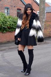 she wears fashion,coat,sweater,skirt,shoes
