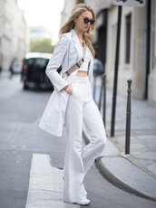 pants,streetstyle,romee strijd,white,crop tops,flare pants,model off-duty,trench coat,coat,Paris Fashion Week 2017