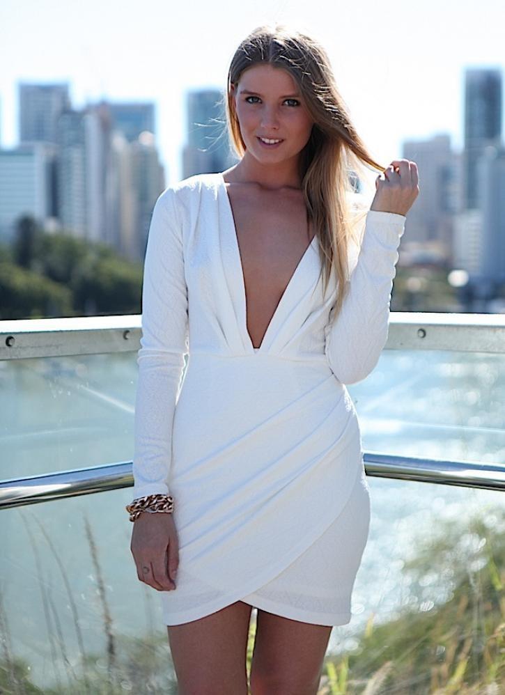White plunge neckline long sleeve drape skirt dress