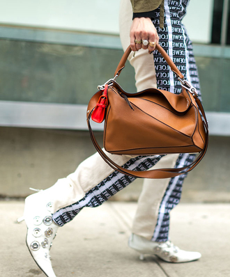 bag nyfw 2017 fashion week 2017 fashion week streetstyle brown bag loewe bag pants white pants monogrammed boots white boots embellished mid heel boots pointed boots kitten heels