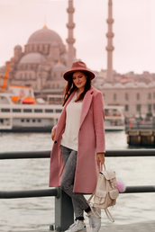 the bow-tie,blogger,coat,hat,white top,pink coat,grey jeans,grey sneakers,backpack,white bag,back to school,fedora,sweater,white sweater,jeans,white sneakers,white backpack
