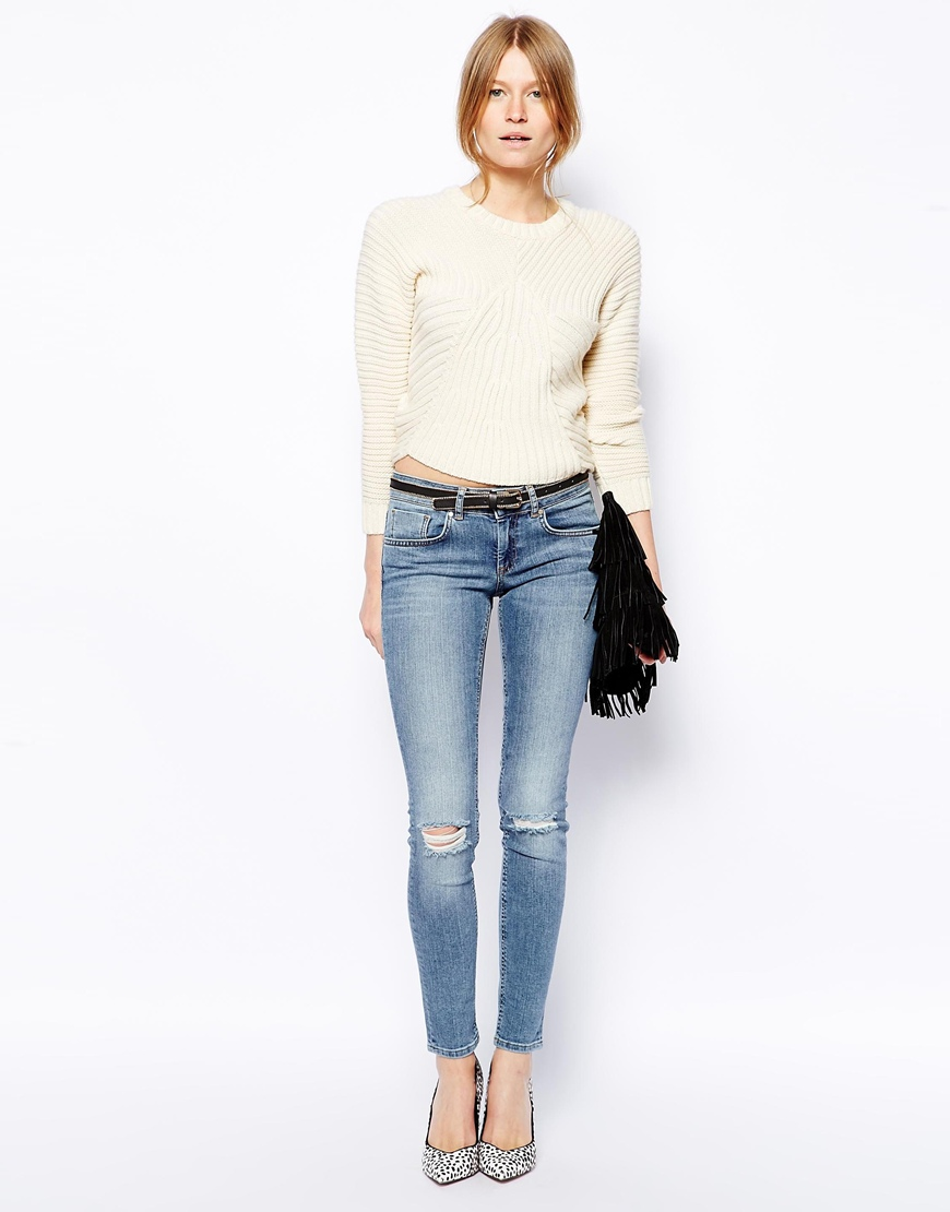 ASOS Whitby Low Rise Skinny Jeans in Columbia Light Wash Blue With Ripped Knees at asos.com