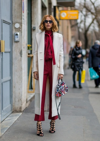bag embellished handbag coat white coat long coat pants red pants shirt red shirt fall outfits sandals sandal heels high heel sandals caged sandals sunglasses streetstyle embellished bag