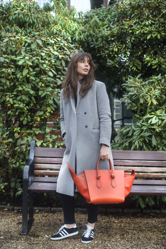 portable package blogger red bag grey coat