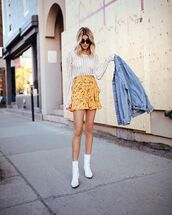 shoes,boots,white boots,skirt,short skirt,yellow skirt,top,white top,sunglasses