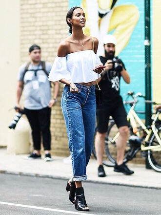 le fashion image blogger jeans peasant top off the shoulder top white top peep toe boots off the shoulder bell sleeves skinny jeans cropped jeans black girls killin it model cropped bootcut jeans cropped bootcut blue jeans white off shoulder top lefashion blouse