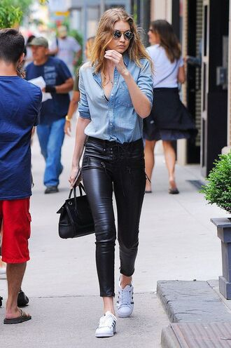 pants black pants leather pants sneakers white sneakers shirt blue shirt denim shirt bag black bag gigi hadid celebrity model sunglasses
