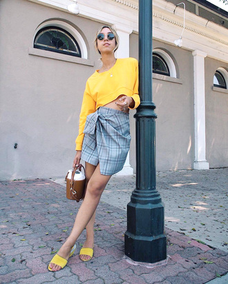 skirt plaid mini skirt mini mini skirt asymmetrical asymmetrical skirt top yellow yellow top crop tops shoes mules handbag bag sunglasses