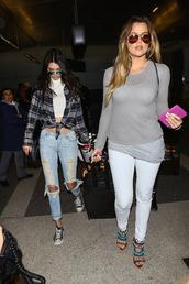 jeans,celebrity,khloe kardashian,ripped jeans,shoes,sunglasses,kendall jenner
