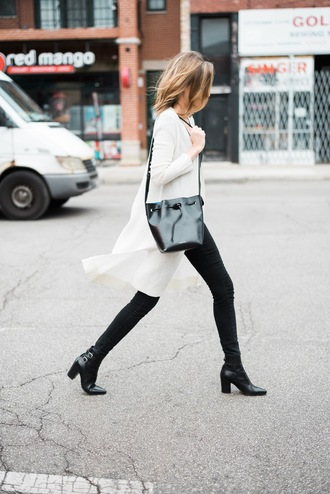see jane blogger black and white bucket bag mid heel boots