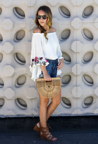 twenties girl style blogger top shorts sunglasses shoes bag jewels cult gaia bag denim shorts sandals summer outfits off the shoulder top