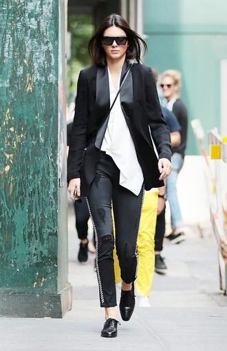 top asymmetrical top asymmetrical white top black blazer blazer pants black pants sunglasses black sunglasses shoes black shoes kendall jenner celebrity style celebrity model model off-duty side stripe pants