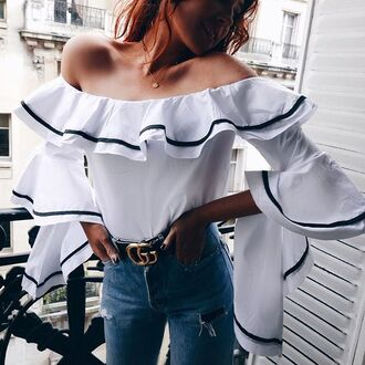 top tumblr ruffle ruffled top white top asymmetrical asymmetrical top off the shoulder off the shoulder top gucci belt denim jeans blue jeans ripped jeans