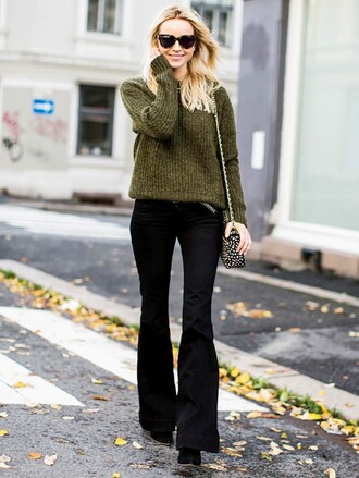 pants green sweater sunglasses black flared trousers black boots blogger