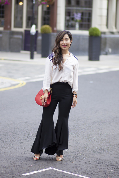 pants white blouse red handbag black flared pants white sandals blogger