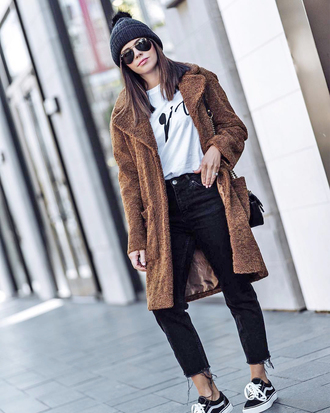 coat white top tumblr brown coat top beanie pom pom beanie denim jeans black jeans teddy bear coat sneakers sunglasses