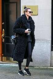 coat,fur,fur coat,hailey baldwin,model off-duty,all black everything,leggings,sneakers,hoodie
