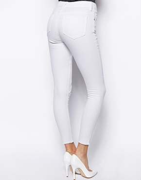 ASOS | ASOS Ridley High Waist Ultra Skinny Ankle Grazer Jeans in White with Ripped Knees and Raw Hem at ASOS