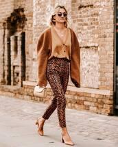 pants,slingbacks,handbag,brown sweater,knitted sweater,earrings,cardigan,leopard print