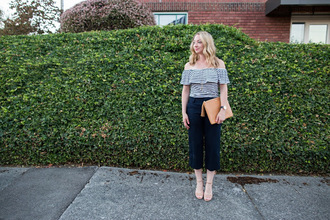 avecamber blogger shoes bag jewels sandals clutch off the shoulder top navy pants striped top fall outfits