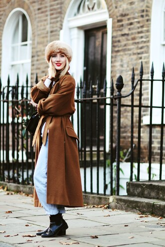 framboise fashion blogger jeans winter outfits rust long coat chelsea boots winter coat hat fur hat coat sweater bag camel long coat