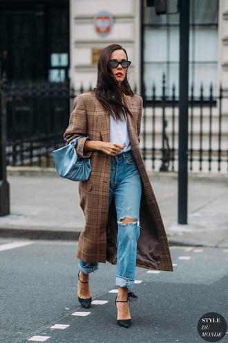 coat brown coat plaid coat plaid shoes jeans denim blue jeans ripped jeans t-shirt